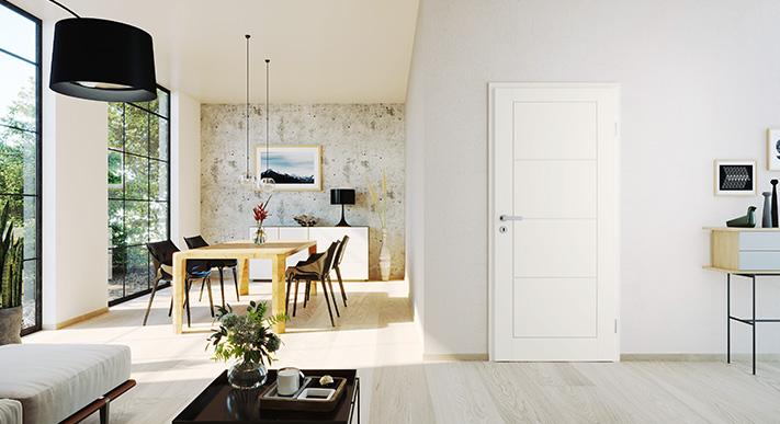 wohnzimmer mit weißer tür