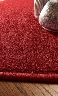 Teppich rot Struktur mit etwas Fußboden und Deko