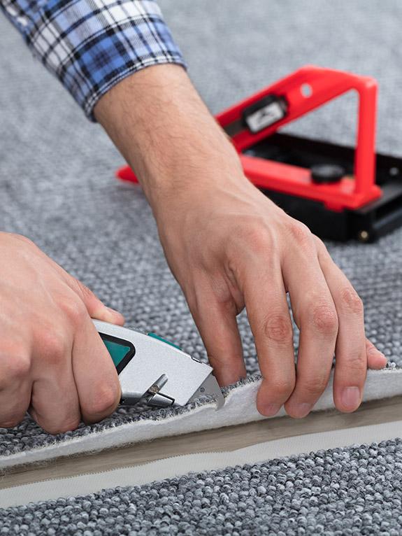 Zuschneiden eines Teppichs